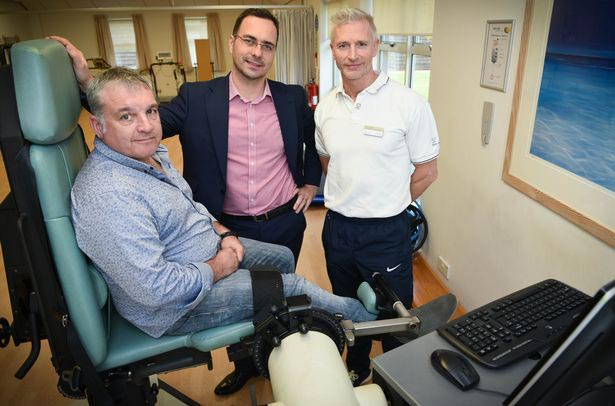 Dad whose legs were paralysed learns to walk again