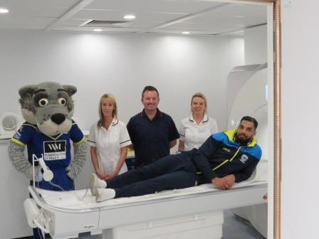 Warrington Wolves star Ryan Atkins and club mascot Wolfie