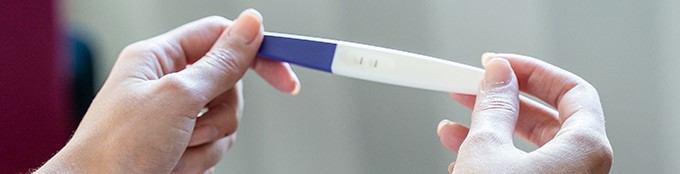 Woman holds a pregnancy test