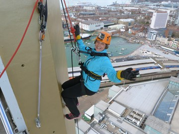 Corinne abseiling down Spinnaker Tower